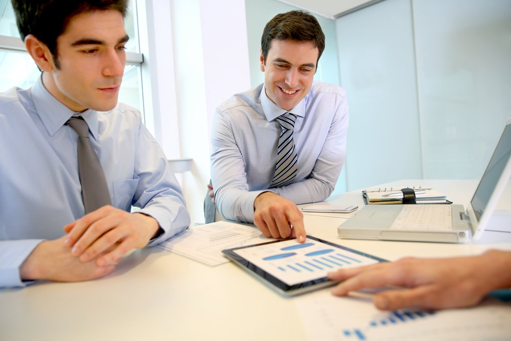Sales people working around table